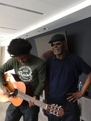 Reggie Payne borrows the guitar of Bill Chase during