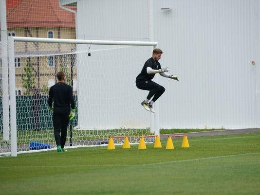 Germany's goalkeeper Marc-Andre Ter Stegen jumps, as other goalkeeper Kevin Trapp watches during a training session at the Fisht stadium in Sochi, Russia, on Sunday, June 18, 2017. Germany will face Australia in a Confederations Cup, Group B soccer match scheduled Monday, June 19, 2017. (AP Photo/Artur Lebedev)