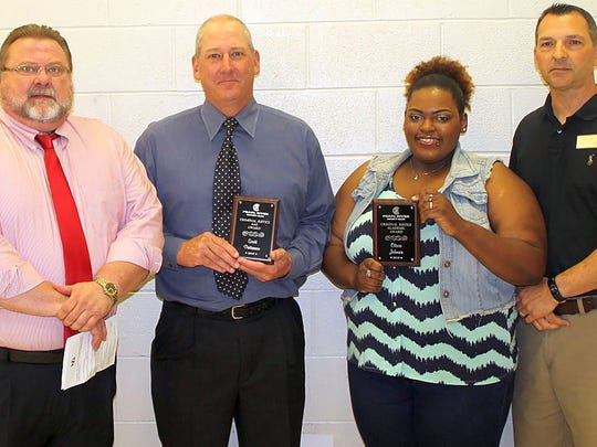 Scott Patterson of Sumrall, second from left, received the criminal justice technology award and Olivia Johnson of McLain received the academic criminal justice award at Pearl River Community College's Forrest County Center. Making the presentations were instructors Randy Johnson, left, and Robbie Johnson.