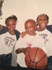 Triplets Maya, Maxwell and Megan Evans grew up playing