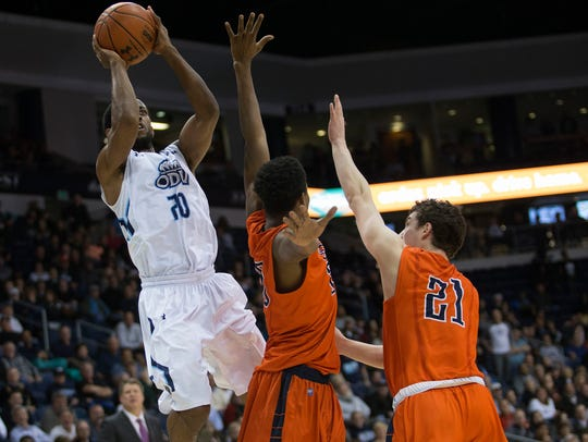 Old Dominion's Trey Freeman (20) takes a shot over