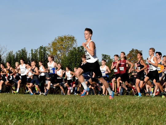 Dustin Horter of Lakota East leads the pack of boys on the gun start of Race one-Division 1 at the 2017 SWDAB Cross Country Championships, Oct. 21, 2017.
