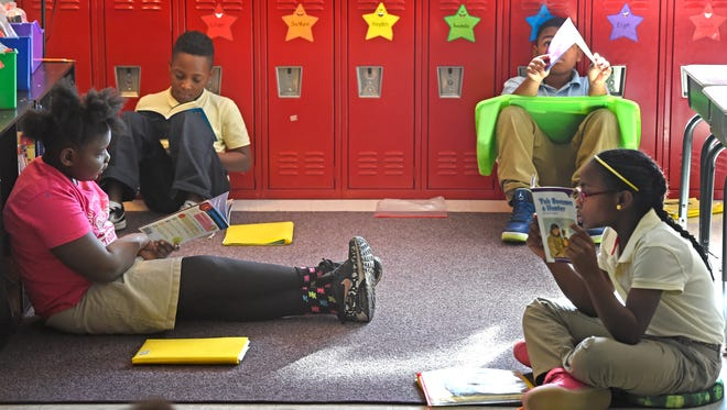 Third grade students lounge on the floor as they read in Jennifer Figueredo's class at Amqui Elementary on Thursday Feb. 16, 2017, in Nashville, Tenn.