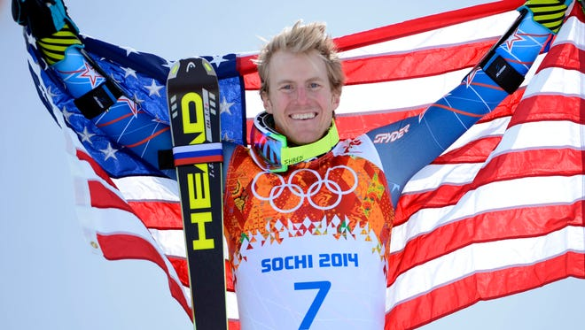 Ted Ligety (USA) celebrates on the podium after winning the gold medal.