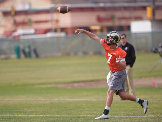 Colorado State University quarterback Nick Stevens runs a drill at football practice on Tuesday, March 21, 2017.