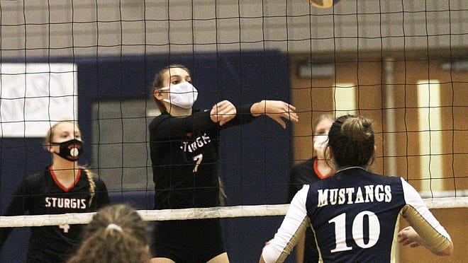 Erika Reed sends a ball back over the net against Portage Central in prep volleyball districts.