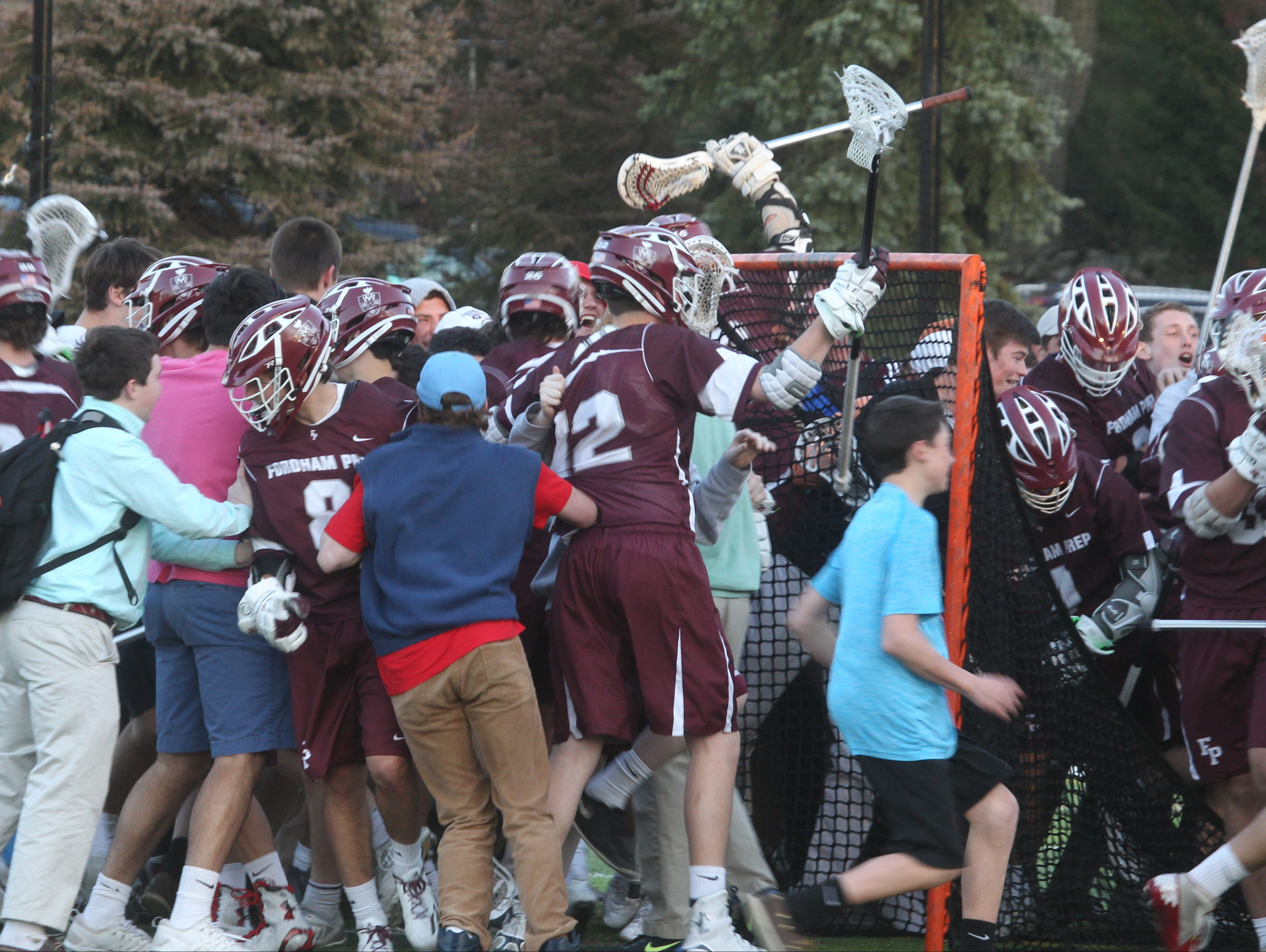 Fordham Prep players and fans celebrate their 8-7 win at Iona Prep April 15, 2016.
