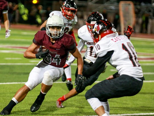 Flour Bluff's Devin Burlingame (34) turns downfield against the San Antonio Southside defense the 5A Division I bi-district playoff game at Hornet Stadium in Flour Bluff on Friday, Nov. 11, 2016.