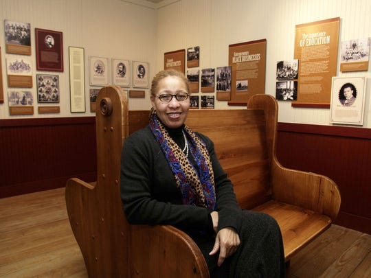 """Juanita Moore, president and CEO of the Charles H. Wright Museum of African American History in Detroit, with an exhibit in February 2007 called """"And Still We Rise""""."""