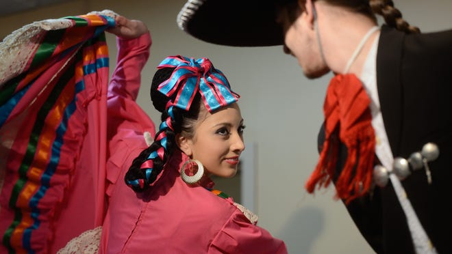 Brenda Aguilar (left) and Nicholas Saldaa of the Tonantzin Dance Company perform at the 20th Annual Community Celebration of Dr. Martin Luther King Jr.'s Birthday on Saturday at Northeast Wisconsin Technical College.