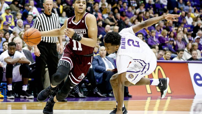 Jan 7, 2017; Baton Rouge, LA, USA; Mississippi State Bulldogs guard Quinndary Weatherspoon (11) drives past LSU Tigers guard Antonio Blakeney (2) during the first half of a game at the Pete Maravich Assembly Center. Mandatory Credit: Derick E. Hingle-USA TODAY Sports