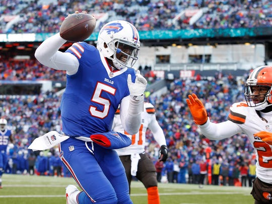 Dec 18, 2016; Orchard Park, NY, USA; Buffalo Bills quarterback Tyrod Taylor (5) is knocked out of bounds by Cleveland Browns strong safety Ibraheim Campbell (24) during the second half at New Era Field. Bills beat the Browns 33-13. Mandatory Credit: Kevin Hoffman-USA TODAY Sports