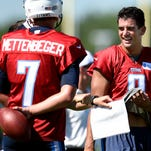 Titans quarterbacks Marcus Mariota, right, and Zach Mettenberger laugh during the first practice of training camp, when Mettenberger's name was misspelled on his jersey.