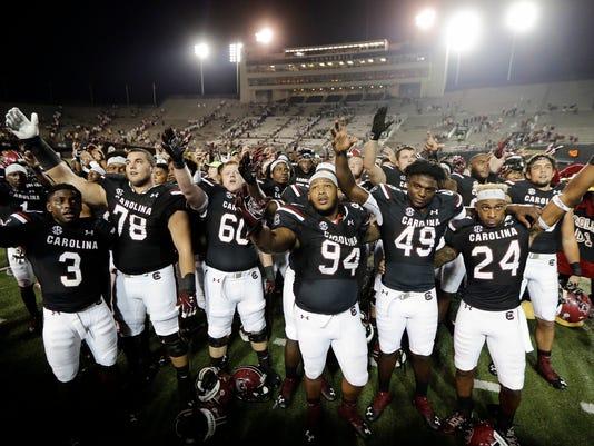 South Carolina players sing the school's alma mater after defeating Vanderbilt 13-10 in an NCAA college football game Thursday, Sept. 1, 2016, in Nashville, Tenn. (AP Photo/Mark Humphrey)