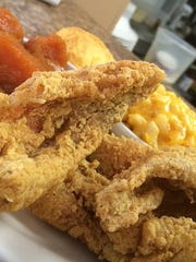 Perch, yams, cornbread macaroni and cheese served at His Place Eatery.