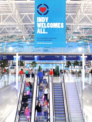 "A new ""Indy Welcomes All"" banner hangs from the ceiling of the terminal at the Indianapolis International Airport welcoming all visitors to the Hoosier State on Friday, April 3, 2015."