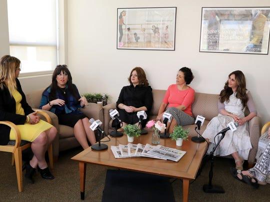 Reporter Rochel Leah Goldblatt, left, interviews Rivkie