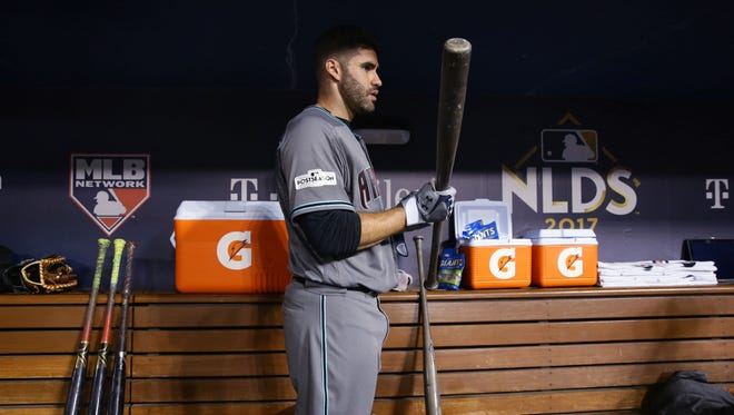 Arizona Diamondbacks slugger J.D. Martinez prepares himself in the dugout minutes before the start the game against the Los Angeles Dodgers in Game 1 of the NLDS on Friday Oct. 6, 2017 at Dodger Stadium in Los Angeles, California.
