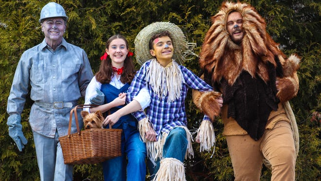 "Dorothy (Hallie Ackerman), Scarecrow (Brennan McKone), Tin Man (Gary Mitchell), and Cowardly Lion (Dale Wayne Williams) in Riverwalk Theatre and All-of-Us Express Children's Theater joint production of ""The Wizard of Oz."""