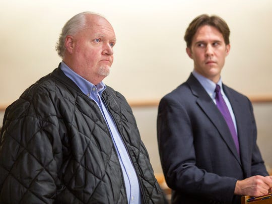 Harold Warren, left, listens to Hamilton County Municipal Judge Tyrone Yates during a hearing for his daughter. At right is assistant prosecutor Zach Kessler. Warren was charged with solicitation.