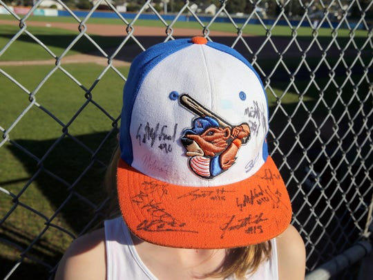 Port Angeles Lefties fan Annika Fox, 10, of Port Angeles displays her autographed hat at Civic Field in Port Angeles.