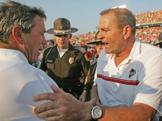 Iowa coach Kirk Ferentz and then-Iowa State coach Dan McCarney meet after the 2005 Cy-Hawk game. The 23-3 victory was McCarney's last over the Hawkeyes as the Cyclones coach.