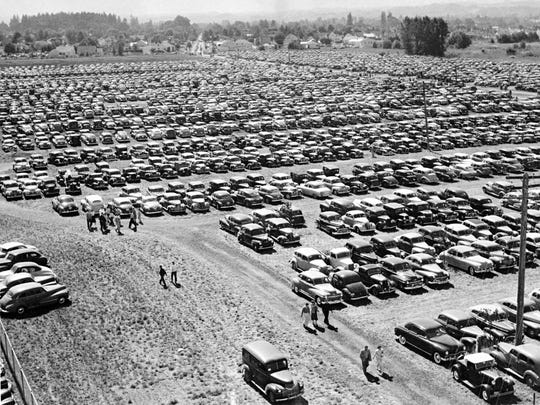 An aerial view of the packed parking lot on opening day of the Oregon State Fair in 1949.