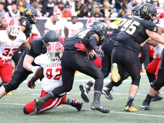 UL defensive lineman Taboris Lee (92), shown here making a tackle in the Appalachian State backfield, is hoping to produce more game-changing plays this season