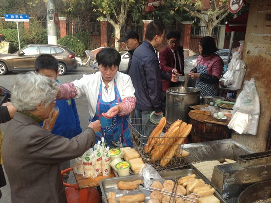 Merchants serve deserts to the lunch-time crowd in Shanghai near Fudan University.
