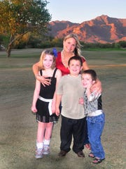 Karen Perry is seen in this undated photo with, from left, Morgan, 9, Logan, 8, and Luke, 6.