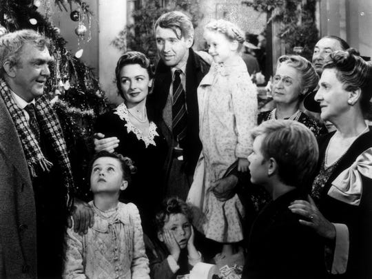 "James Stewart (center) has a change of heart (with a little help) in ""It's A Wonderful Life."""