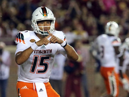 FILE - In this Oct. 10, 2015, file photo, Miami quarterback Brad Kaaya calls a play during an NCAA college football game against Florida State in Tallahassee, Fla. The Hurricanes have new coach in Mark Richt and are a decade removed from their last bowl win, but possess a bona fide star in Kaaya–a junior widely expected to turn pro after this season and who has Miami's now-annual hopes for a resurgence resting squarely on his shoulders. (AP Photo/Steve Cannon, File)