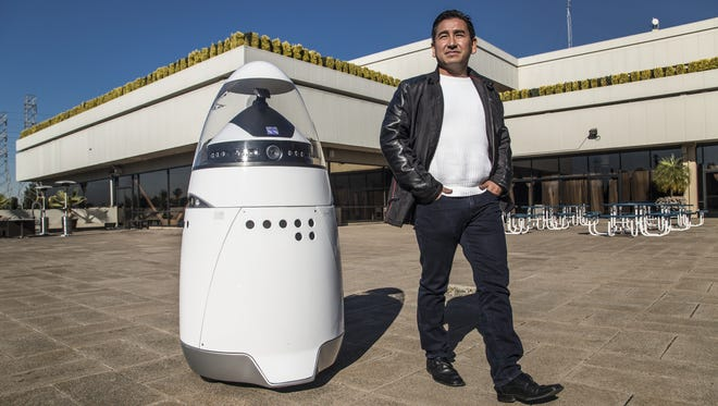 William Santana Li, 43, chairman and CEO of Knightscope poses with their K5 robot at the company's Sunnyvale, CA.