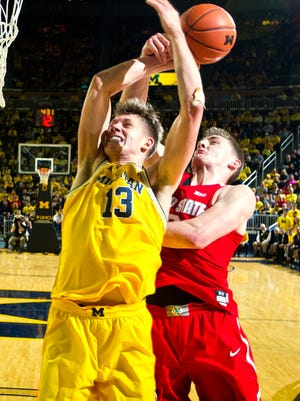 Michigan forward Moritz Wagner (13) has a shot attempt deflected by Ohio State center Micah Potter, right, in the first half.