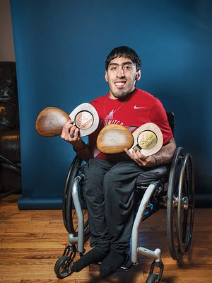 Paralympic gold medalist Gianfranco Iannotta posed for photos with some of his medals at his Garfield, NJ home.