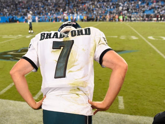 Oct 25, 2015; Charlotte, NC, USA; Philadelphia Eagles quarterback Sam Bradford (7) reacts on the sidelines in the fourth quarter. The Panthers defeated the Falcons 27-16 at Bank of America Stadium. Mandatory Credit: Bob Donnan-USA TODAY Sports