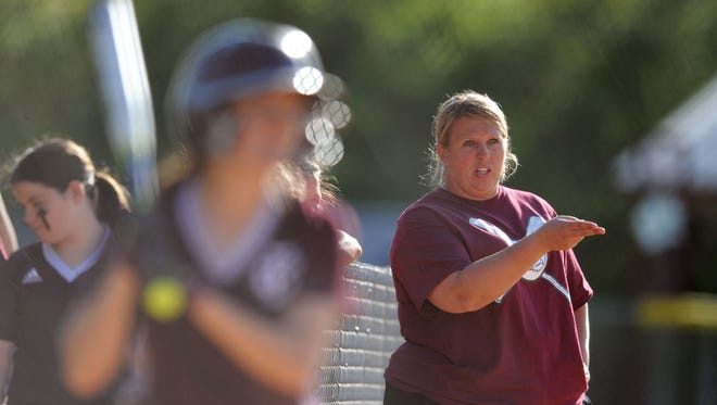 Forrest County AHS softball coach Kacie Roberson directs her team Thursday during a game against Moss Point.