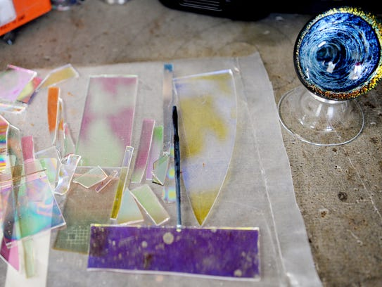 Shards of glass on a table in Jamie Wickliffe's home studio November 10, 2017.