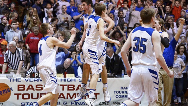 Williamstown players including Nathan Poulin, center left, and Brandon Carrier, center right, celebrate after the top-seeded Blue Devils defeated second-seeded Hazen Union, 66-54, in the Division III championship at Barre Auditorium on Saturday. It was the Blue Devils' fifth title in six years.