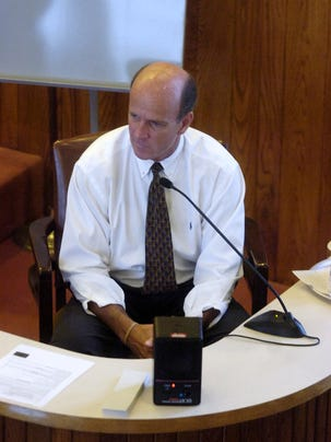 During his 2009 retrial, Cal Harris reacts to the sight