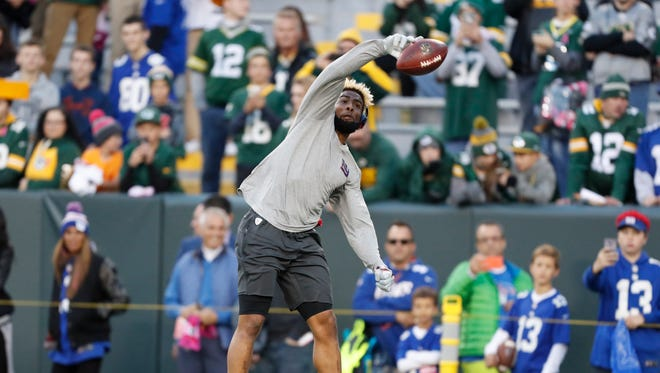 New York Giants' Odell Beckham warms up before an NFL football game against the Green Bay Packers Sunday, Oct. 9, 2016, in Green Bay, Wis.