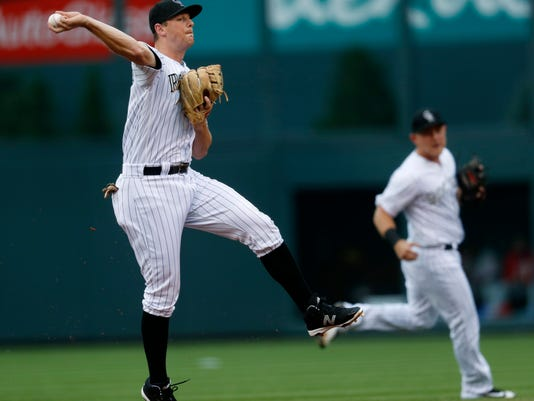 Colorado Rockies second baseman DJ LeMahieu throws to first base to put out Philadelphia Phillies' Cesar Hernandez during the first inning of a baseball game Saturday, Aug. 5, 2017, in Denver. (AP Photo/David Zalubowski)