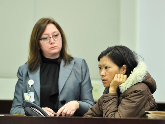 Sawng Hing, listens in Judge Steve Dozier's courtroom,