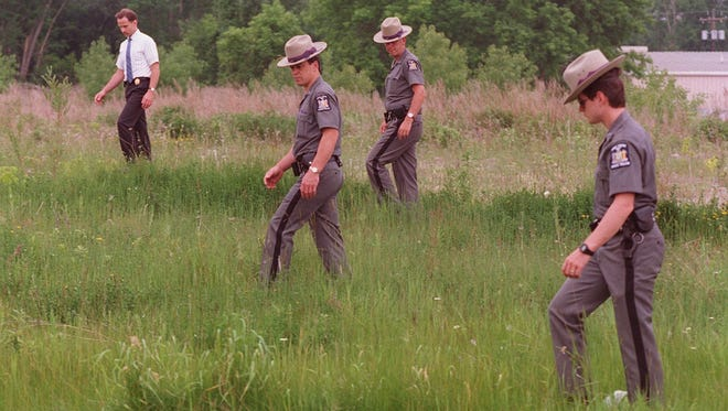 State police search the area around Panorama Plaza during their investigation of the disappearance of Sandra Sollie of Macedon.