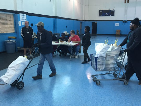 City of Monroe crew helped distribute food bags to