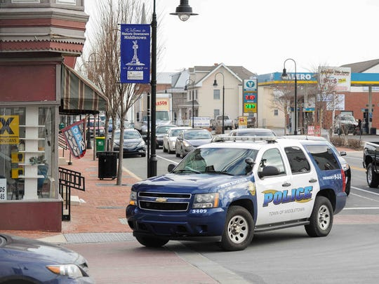 A Middletown Police SUV turns off Main Street onto Broad in downtown Middletown.