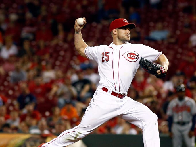 Aug. 21: Reds' Skip Schumaker pitches a scoreless ninth inning in the Reds' 8-0 loss to the Braves. It marks his fourth career appearance on the mound in the big leagues.