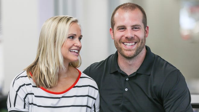 Jason and Colette Seaman pose for a portrait after receiving a car from Napleton Hyundai of Carmel for Jason's recent heroic acts, in Carmel, Ind., Wednesday, June 13, 2018. Jason, the Noblesville West Middle School science teacher stopped a school shooter in his classroom, taking three bullets in the process. One 13-year-old student, Ella Whistler, continues to recover from serious injuries she suffered in the shooting.