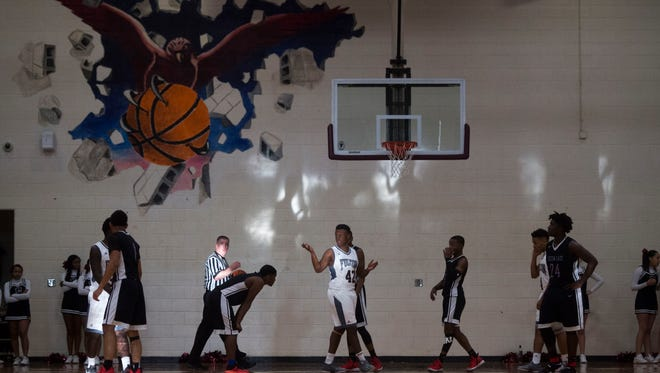 Sunlight hits the court during a game between Fulton and Austin-East at Fulton High School Saturday, Jan. 6, 2018. Fulton defeated Austin-East 73-51.