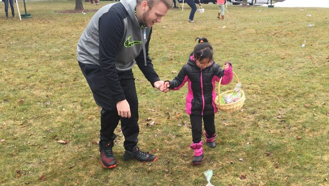 Student volunteer Matt Warner, left, helps Leah Lambertus of Poughquag during the Town of Union Vale's adaptive Easter egg hunt Saturday, April 1, 2017.